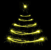 Christmas tree-shaped sparklers on black background — Stock Photo