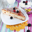Stockfoto: Cheese casserole with raisins on plate on napkin on wooden table close-up