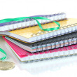 Stock Photo: Medal for achievement in education and notebooks isolated on white