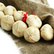 Vintage garlic and pepper decoration, on sackcloth, isolated on white — Stock Photo #35450633