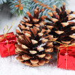 Christmas decoration with pine cones on wooden background — Stok fotoğraf #35450841