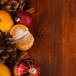Christmas tangerines and Christmas toys on wooden table close-up — Stock Photo