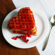 Sweet Belgium waffles with jam, on wooden table background — ストック写真
