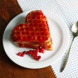 Sweet Belgium waffles with jam, on wooden table background — 图库照片