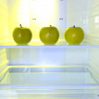 Apples in open empty refrigerator. Weight loss diet concept. — Stock Photo