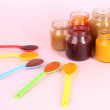 Stock Photo: Baby puree on pink background