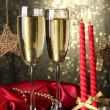 Two glasses of champagne on bright background with lights — Stock Photo #35452405