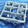 Stock Photo: Christmas toys in wooden box on blue background