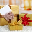 Gift boxes with blank label on carpet on bright background — Stock Photo