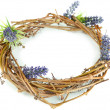 Stock Photo: Wreath of dry branches with flowers isolated on white