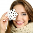 Beautiful smiling girl with Christmas snowflake isolated on white — ストック写真
