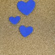 Blue hearts made of felt on golden background — Stock Photo #35454673