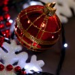 Christmas ornaments and garland on wooden background close-up — Stock Photo