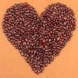 Heart of sunflower grains in chocolate, on brown background — Stock Photo