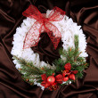 Christmas wreath on fabric background — Stock Photo #35455395