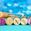 Wine corks with corkscrew on wooden table on blue background — Stock Photo