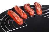 Delicious sausages in wok isolated on white — Stock Photo