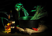 Witch in scary Halloween laboratory on dark color background — Foto de Stock