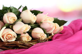 Beautiful bouquet of roses, on fabric, on light background — Stock Photo