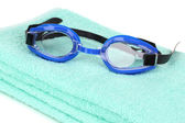 Swim goggles on towel isolated on white — Foto Stock
