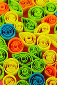 Colorful quilling on pink background close-up — Zdjęcie stockowe