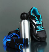 Different tools for sport on grey background — Stock Photo