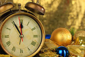 Composition of clock and christmas decorations on bright background — Stok fotoğraf