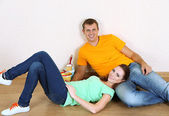 Young couple resting from renovation in new flat — Stock Photo