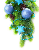 Christmas balls and decorative stars on fir tree, isolated on white — Zdjęcie stockowe