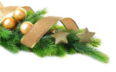 Christmas balls and decorative stars on fir tree, isolated on white — 图库照片