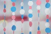 Decorative felt garland on bright background — Stockfoto