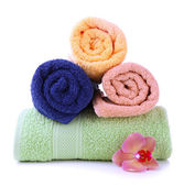 Orchid flower and towel rolls, isolated on white — Stock Photo