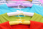 T-shirts on hangers close-up — Photo
