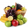 Composition of different fruits with basket isolated on white — Stock Photo