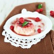 PannCottwith raspberry sauce, on wooden background — Stock Photo #35522209