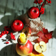 Composition with apples and candle on wooden background — Lizenzfreies Foto