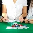 People playing cards at table — Stock Photo