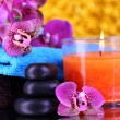 Beautiful spa setting with orchid on yellow background — Stock Photo