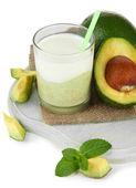 Fresh avocado smoothie isolated on white — Stock Photo