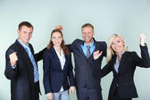 Group of business people on gray background — Stock Photo