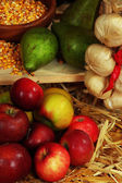Pears on shelf and apples on straw close up — Stock Photo