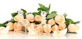 Beautiful bouquet of roses and perfume, isolated on white — Stock Photo