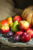 Autumn composition of fruits and pumpkins on table close-up — Stock Photo