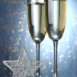 Two glasses of champagne on bright background with lights  — Photo