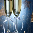 Two glasses of champagne on bright background with lights  — Stok fotoğraf