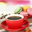 Coffee and macaroons on table on light background — Stock Photo
