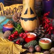 Composition for Halloween with pumpkins and candles close-up — Photo