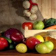 Composition of different fruits and vegetables on table on sackcloth background — Stock Photo #35574253