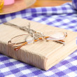 Composition with old book, eye glasses, and plaid on wooden background — Stock Photo #35575135