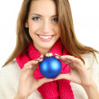 Beautiful smiling girl with Christmas ball isolated on white — Stock Photo #35575363